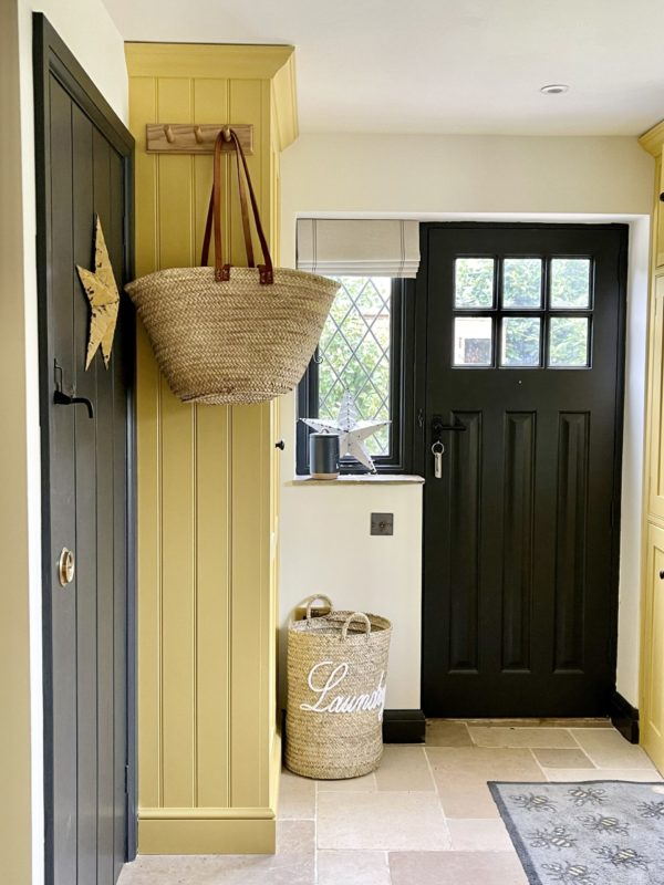 laundry basket in a yellow utility room