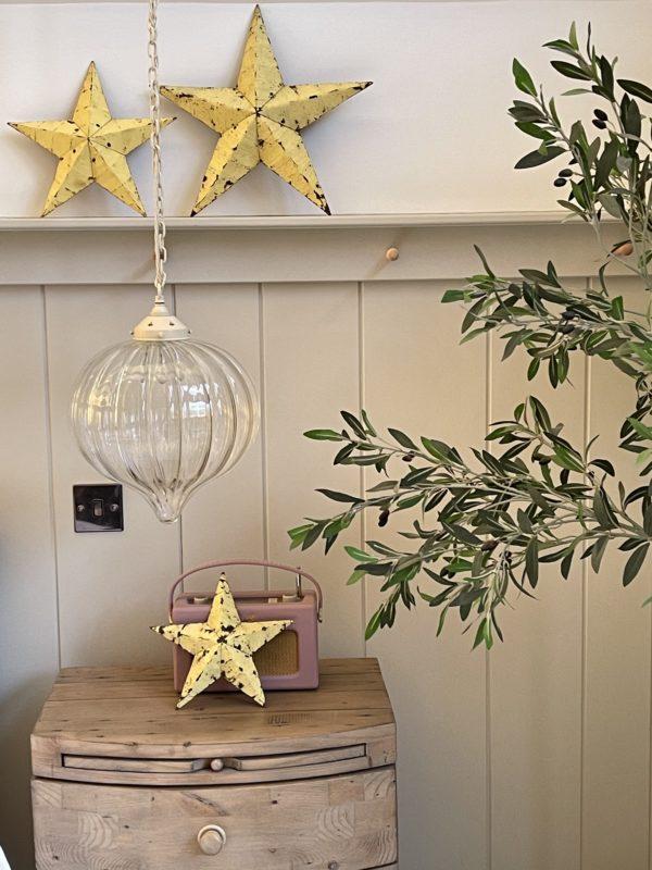 small yellow amish barn star