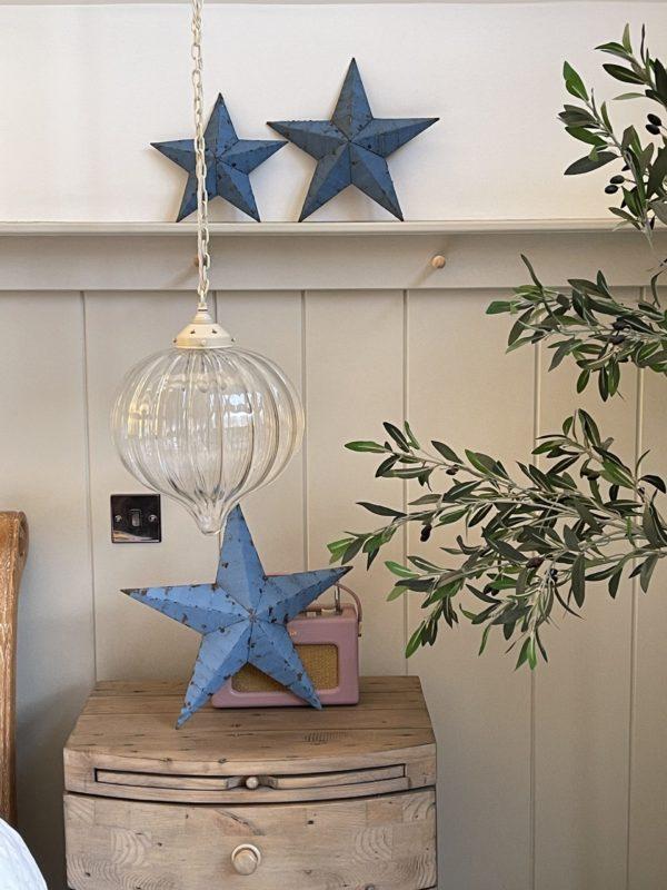 large blue barn star