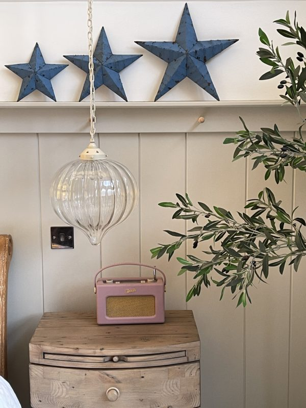 a group of chippy paint blue barn stars