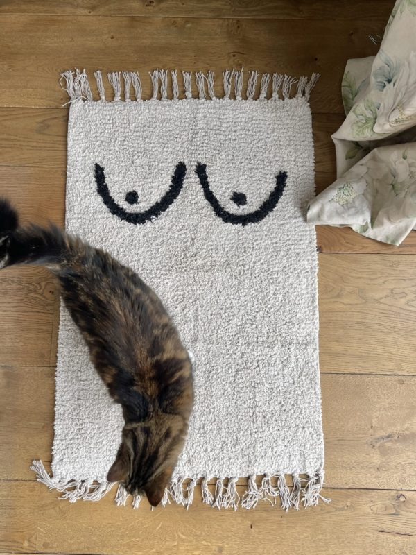 a cotton mat with boobs on
